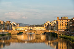 Arno River and Bridges Florence. Florence, Italy-June 12, 20015.View of the Arno River and the buildings along it`s banks, looking towards the Ponte Santa Royalty Free Stock Photo
