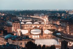 Arno River and bridges Ponte Vecchio Stock Images