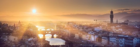 Arno River and bridges at sunset Florence, Italy. Panoramic aerial view of Florence during sunset with sun rays from Michelangelo square, Italy Stock Photos