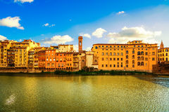 Arno river and buildings architecture landmark on sunset Stock Photography