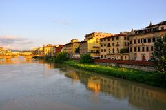Arno river, Florence. The Ponte Vecchio in Florence, Italy, is a Medieval bridge over the Arno River, in Florence, Italy, noted for still having shops built stock images