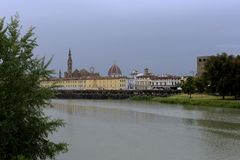 The Arno river in Florence and the dome of the cathedral stock photography