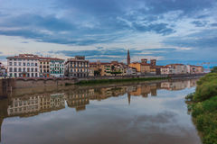 Arno river Florence,Italy. Arno river (Florence,Firenze Italy) and buildings reflection on the water,evening landscape Royalty Free Stock Photo