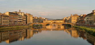Arno River Florence. Florence, Italy-June 12, 20015.View of the Arno River and the buildings along it`s banks, looking towards the famous Ponte Vecchio bridge in Royalty Free Stock Photo