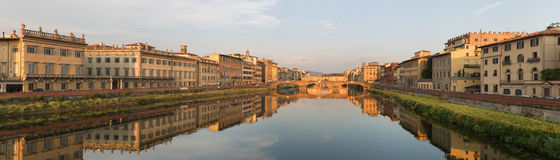 Arno River Florence. Florence, Italy-June 12, 20015.View of the Arno River and the buildings along it`s banks, looking towards the famous Ponte Vecchio bridge in Stock Photography