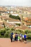 Arno River flowing through Florence, Italy. A paroramic view of Florence, Italy showing the Arno River flowing through the city. A church is in the foreground Stock Images