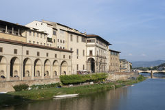 Arno river flowing through Florence next to Uffizi gallery Stock Photos