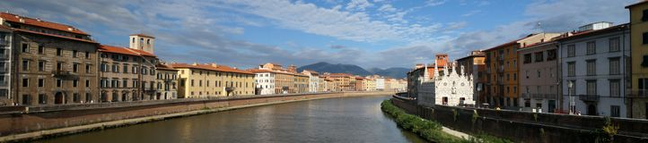 Arno River in Pisa. Buildings and church along the Arno River in Pisa, Italy royalty free stock photos