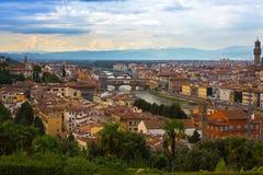Arno river, Ponte Vecchio bridge, clock tower of Old Palace in e Royalty Free Stock Photos