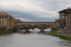 Arno river and Ponte Vecchio bridge in Florence. Tuscany, Italy stock photography