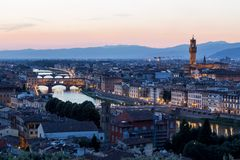 Arno river and Ponte Vecchio in Florence at night Stock Photos