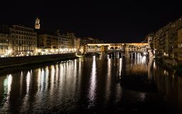 Arno river and Ponte Vecchio in Florence at night Royalty Free Stock Photos