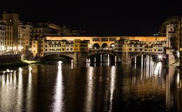 Arno river and Ponte Vecchio in Florence at night Stock Images