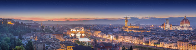 Arno River and Ponte Vecchio at sunset, Florence. Arno River, Ponte Vecchio, Vecchio Palace, Basilica of Santa Croce at sunset Florence royalty free stock photos