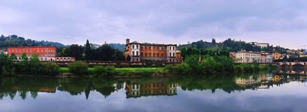 Arno River with reflections at Florence. Royalty Free Stock Photo
