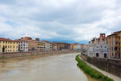 The Arno River and the small Gothic church of Santa Maria della Spina on the waterfront of Pisa. Cloudy, rainy weather. Pisa, Italy stock images