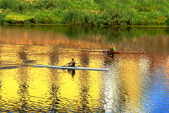 Arno River and two rowers on a boats. Florence, Italy. Stock Photo