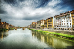 Arno river under a dramatic sky in Florence Royalty Free Stock Images