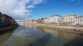 Arno River, waterway, reflection, sky, water. Arno River is waterway, water and cloud. That marvel has reflection, landmark and town and that beauty contains sky royalty free stock photography