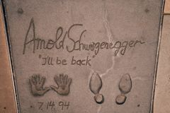 Arnold Schwarzenegger feet and hands prints I`l be back. September 2016 - Arnold Schwarzenegger feet and hands prints at the TCL Chinese Theatre in Hollywood Los Royalty Free Stock Images