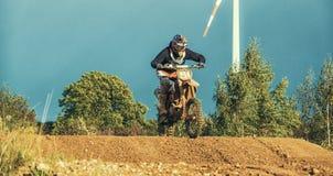 Motocross MX Rider riding on dirt track Royalty Free Stock Photo
