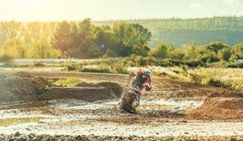 Motocross MX Rider riding on dirt track. Arnoldsweiler, Germany, October 05,2017:Extreme Motocross MX Rider riding on dirt track on a sunny late summer day on Stock Photo