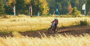 Motocross MX Rider riding on dirt track Stock Photos