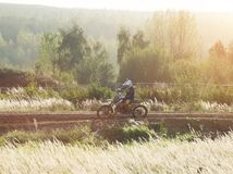 Motocross MX Rider riding on dirt track Royalty Free Stock Photography