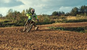 Motocross MX Rider riding on dirt track. Arnoldsweiler, Germany, October 05,2017:Extreme Motocross MX Rider riding on dirt track on a sunny late summer day on Royalty Free Stock Image
