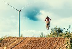 Motocross MX Rider riding on dirt track. Arnoldsweiler, Germany, October 05,2017:Extreme Motocross MX Rider riding on dirt track on a sunny late summer day on Stock Image