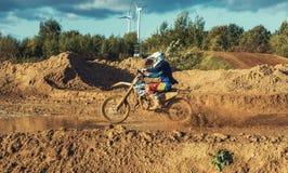 Motocross MX Rider riding on dirt track Stock Photography