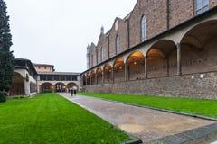 Arnolfo cloister of Basilica Santa Croce in rain. FLORENCE, ITALY - NOVEMBER 6, 2016: Arnolfo cloister of Basilica di Santa Croce Basilica of the Holy Cross in Stock Photos