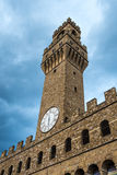 Arnolfo tower, Palazzo della Signoria and Palazzo Vecchio, Piazz. Arnolfo tower, clock with only one hand, bottom perspective view of the Palazzo della Signoria Royalty Free Stock Image