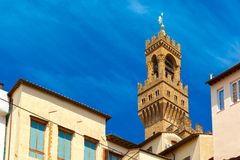 Arnolfo tower of Palazzo Vecchio, Florence, Italy stock photography