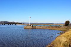 Arnside Pier and viaduct at high tide Stock Photography