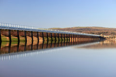 Arnside Railway Viaduct over River Kent estuary. View of Arnside Viaduct carrying the Furness railway line over the River Kent estuary seen at high tide, Cumbria Royalty Free Stock Photo