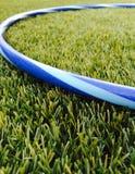 Aro de Hula na grama Imagens de Stock
