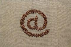 Arobase由咖啡豆做了 库存图片