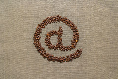 Arobase made from coffee beans Stock Images