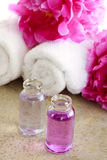 Arom oil with pink peony and towels Stock Photography