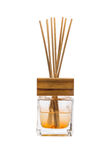 Aroma bottle glass and wooden sticks isolated. Aroma bottle glass and wooden sticks on white backgrond Royalty Free Stock Photo