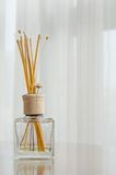 Aroma bottle glass and wooden sticks Royalty Free Stock Photography