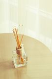 Aroma bottle glass and wooden sticks Royalty Free Stock Photo