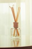 Aroma bottle glass and wooden sticks Royalty Free Stock Image