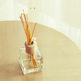 Aroma bottle glass and wooden sticks Stock Photos