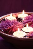Aroma Bowl with Candles and Flowers. In Violet Stock Photo