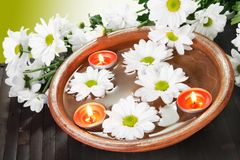 Aroma Bowl with Flowers and Candles Royalty Free Stock Photo