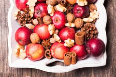 Aroma Christmas. Apples, cones, nuts and cookies with spices. Aroma Christmas Royalty Free Stock Image
