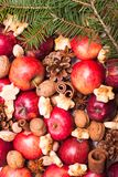 Aroma Christmas. Apples, cones, nuts and cookies with spices. Aroma Christmas Stock Image