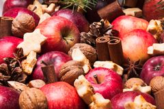 Aroma Christmas. Apples, cones, nuts and cookies with spices. Aroma Christmas Royalty Free Stock Photography
